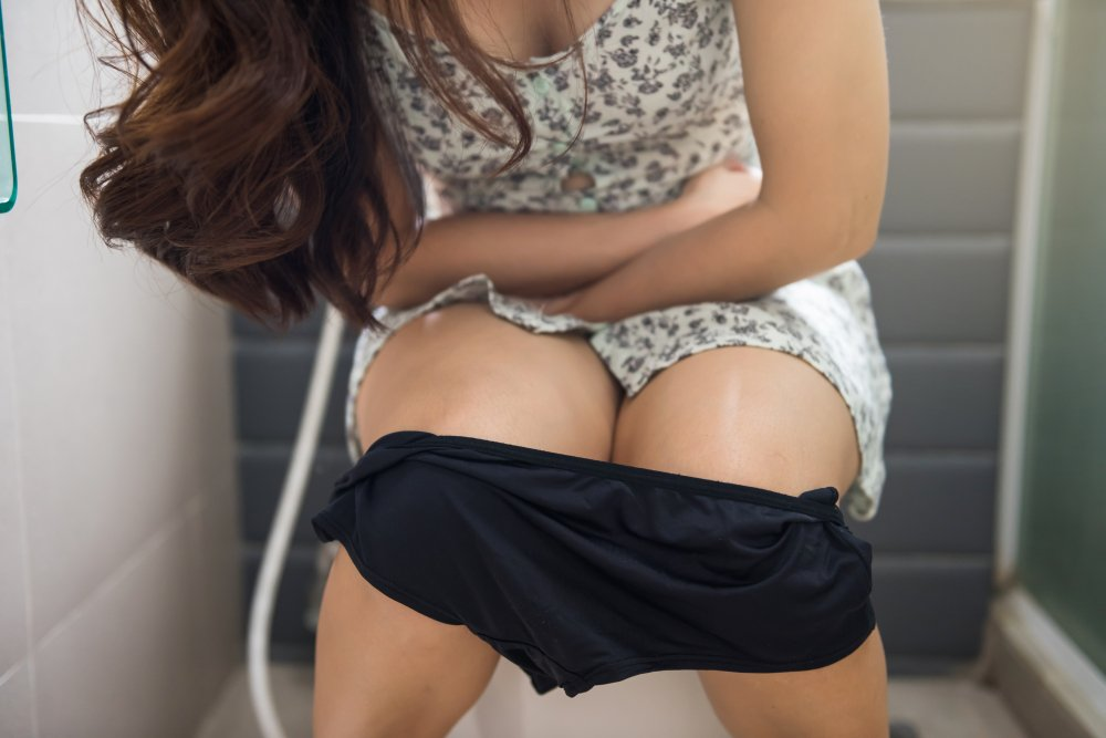 woman in pain when urinating