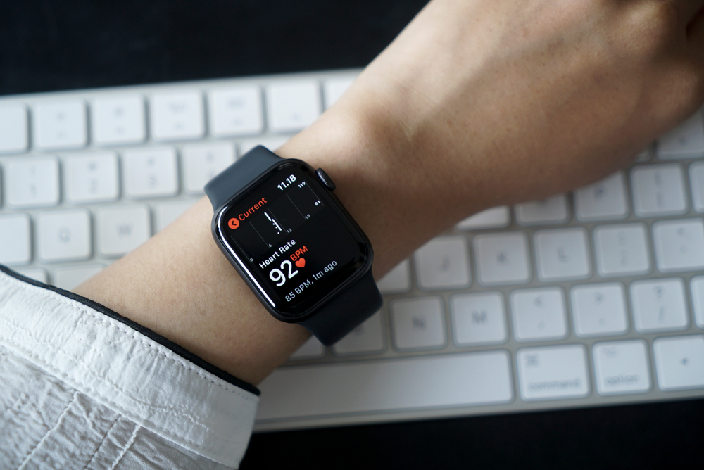 office person checking heart rate on watch