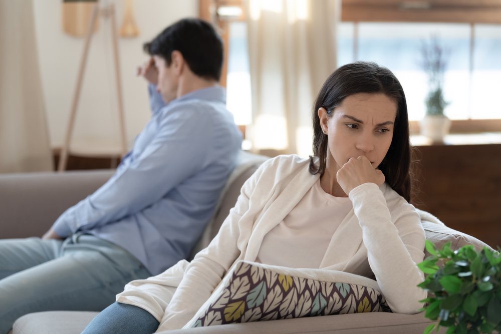 couple on couch angry with each other