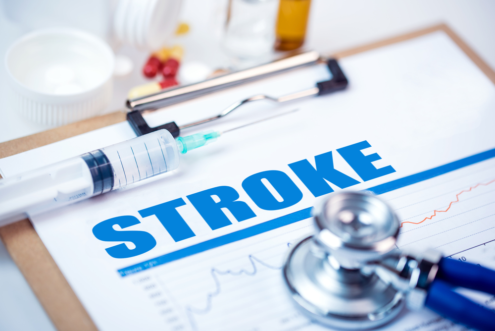 """medical concept """"stroke"""" on clipboard with needle and stethoscope"""
