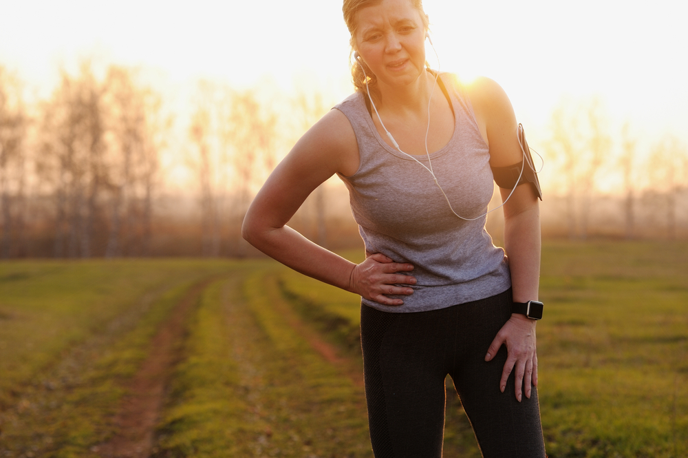 woman running in the morning with pain in side
