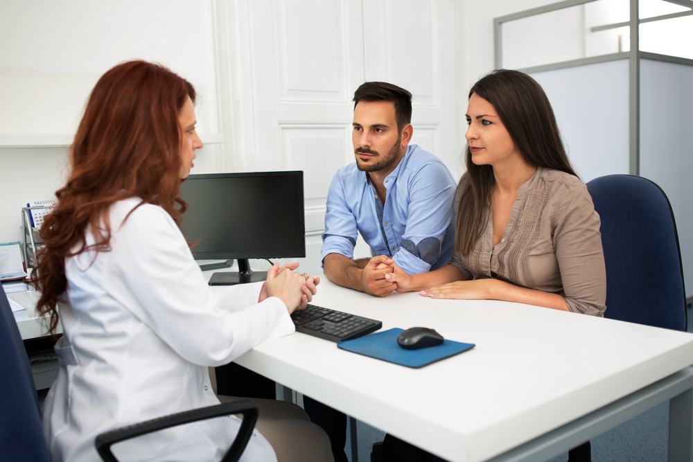 expectant parents talking to a doctor