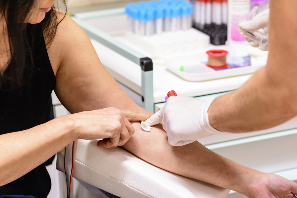 a person having their blood taken at a clinic
