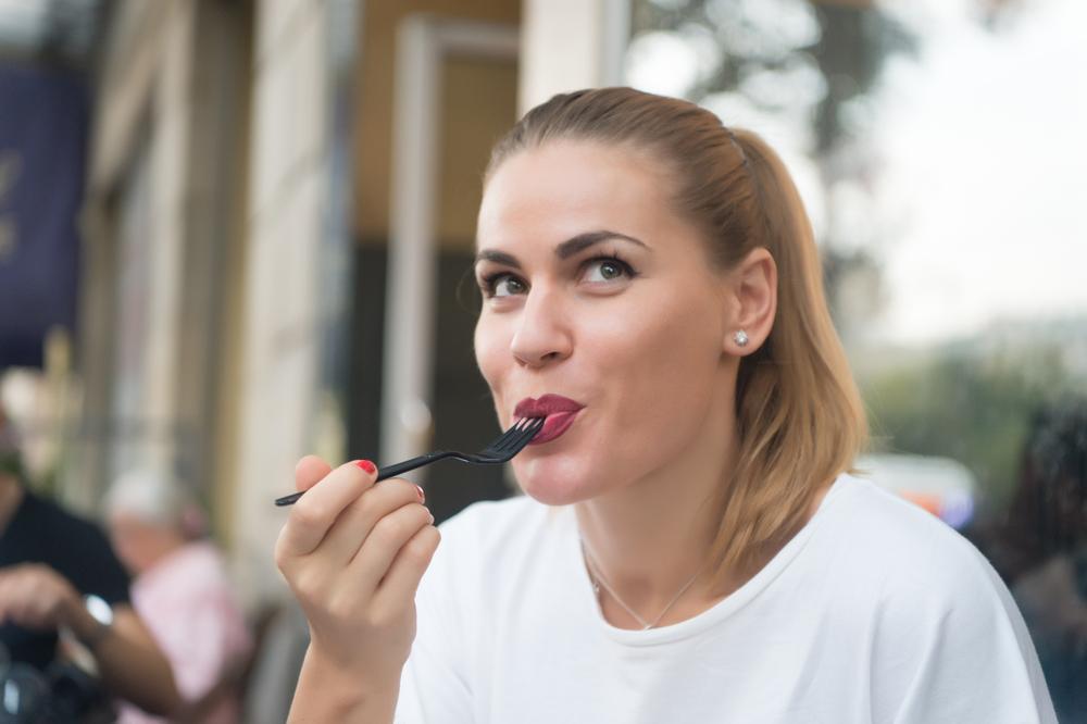 happy woman eating outside