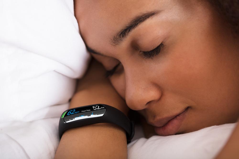 woman sleeping wearing fitness tracker