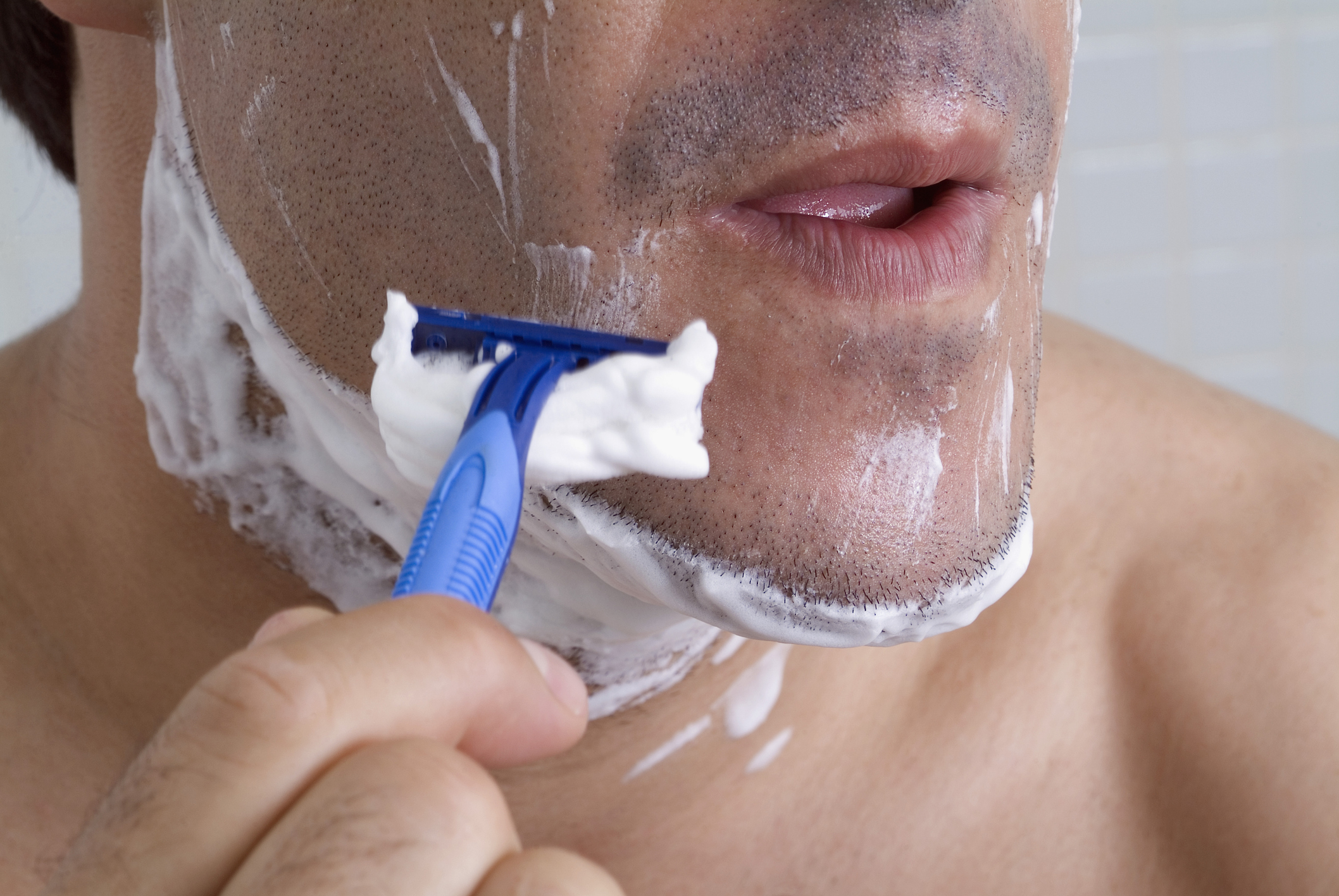 Extreme close-up of man shaving