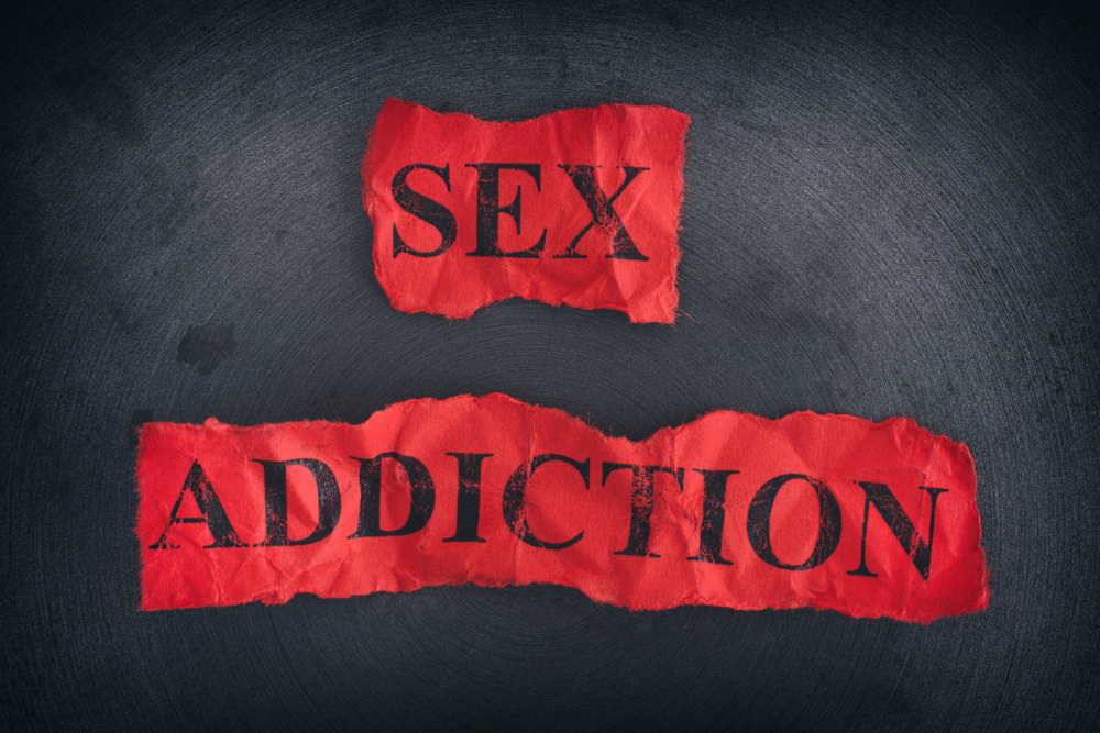 the words sex addiction on a red background