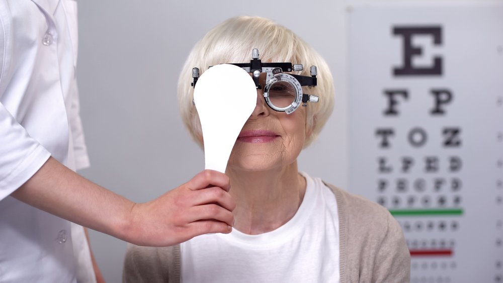 older woman getting eye exam