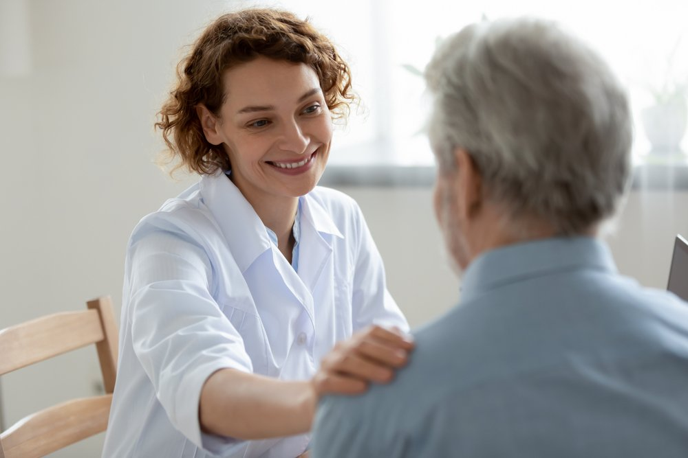 female doctor comforting male patient
