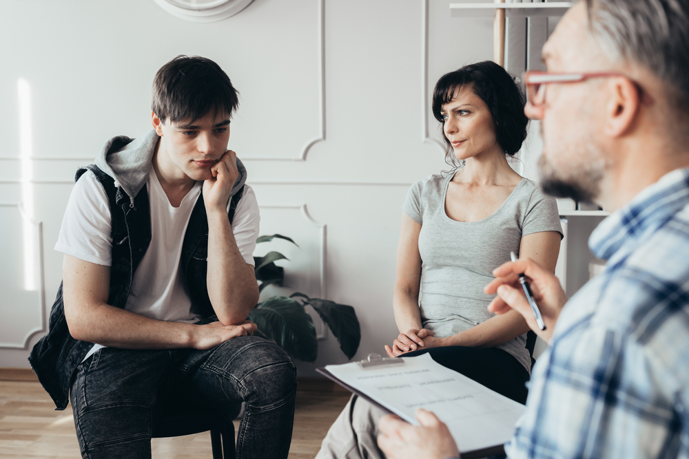young man in counselling with his mother for addiction