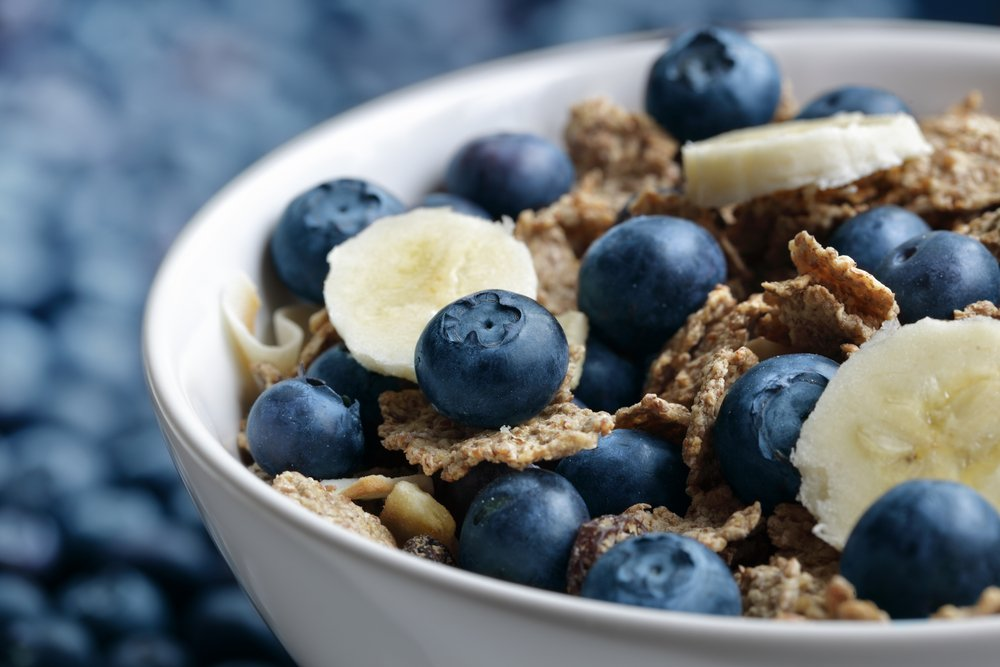cropped image of high-fiber cereal with blueberries and banana