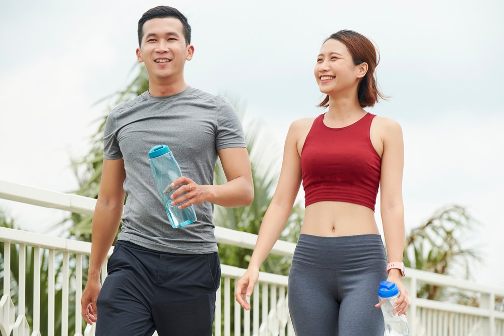 smiling couple walking after a workout