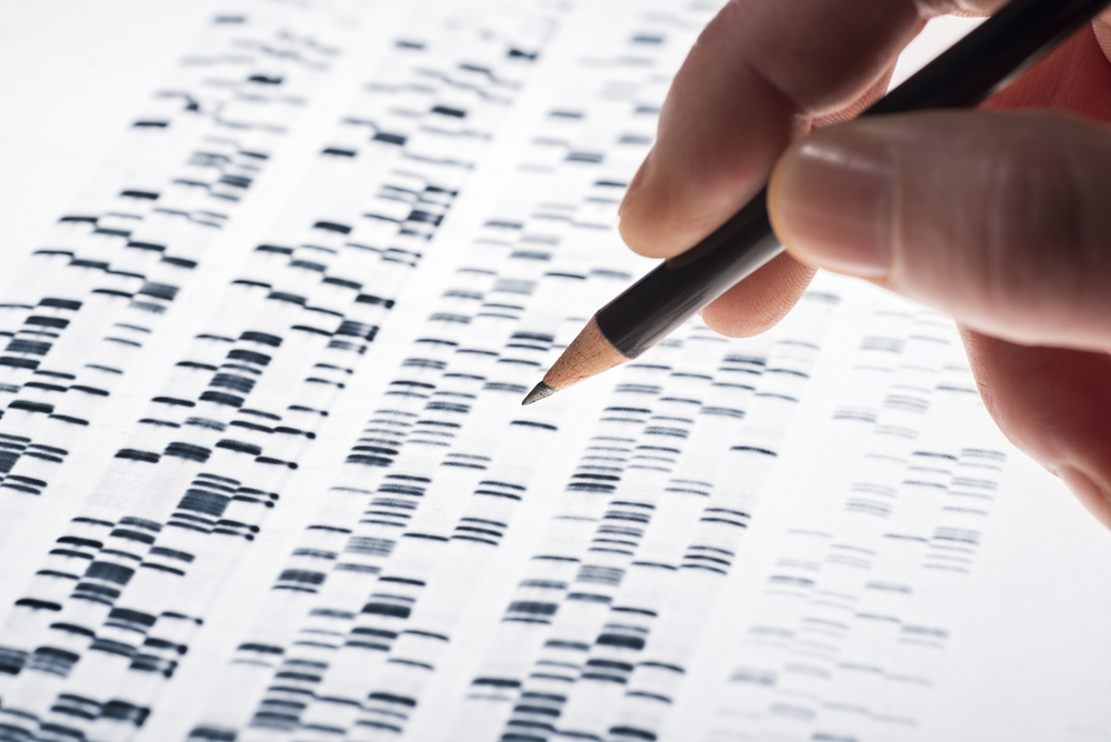 doctor studying DNA genetic results