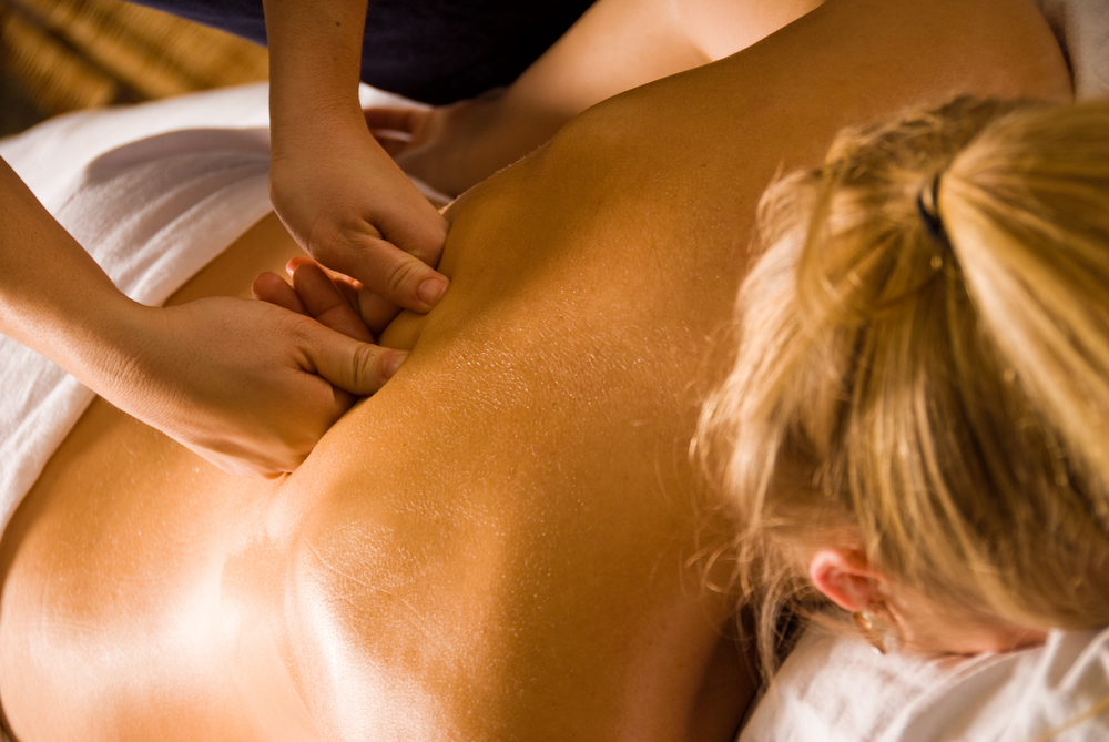 a woman having a deep tissue massage treatment