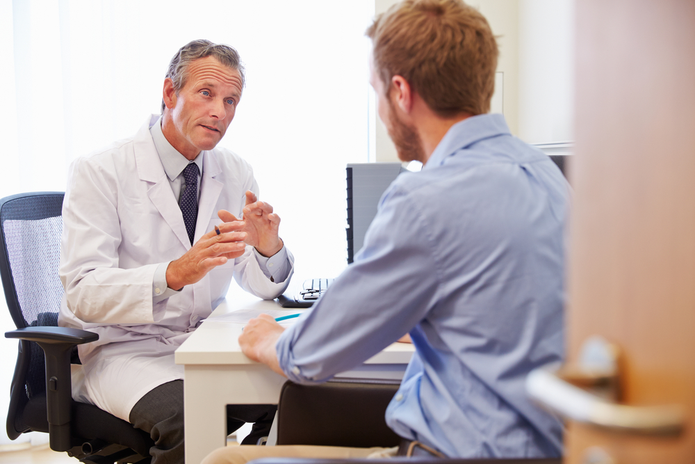 doctor discussing with a male patient