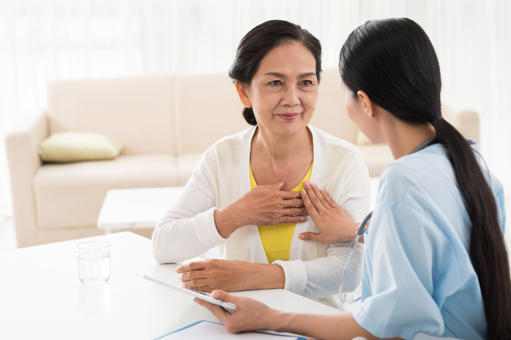 doctor and patient discussing her heart health