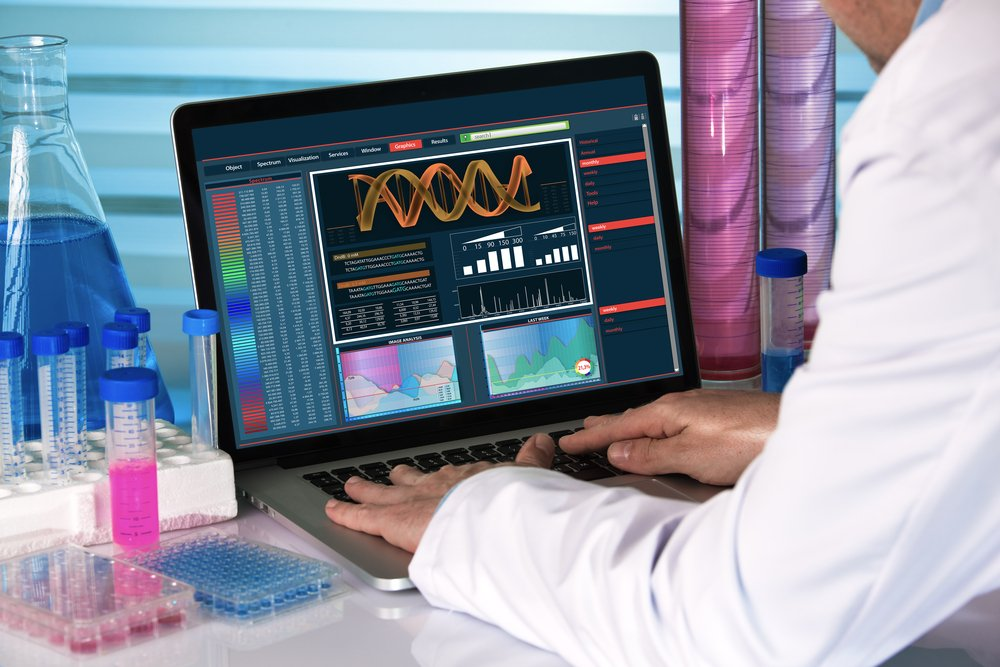 doctor looking at DNA sequencing on laptop