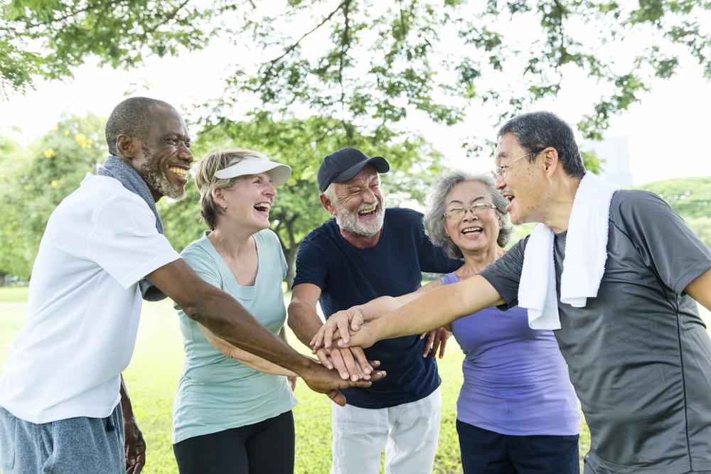 five fit older people celebrating together