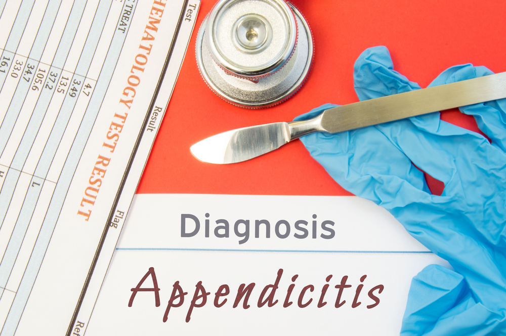 diagnosis concept with stethoscope and scalpel - appendicitis