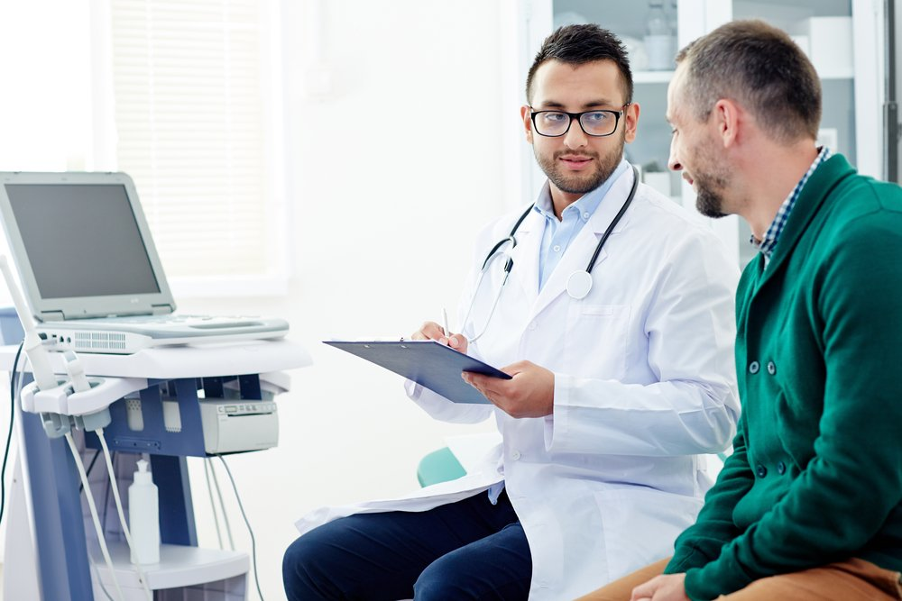 doctor and patient discussing treatment in doctor's office