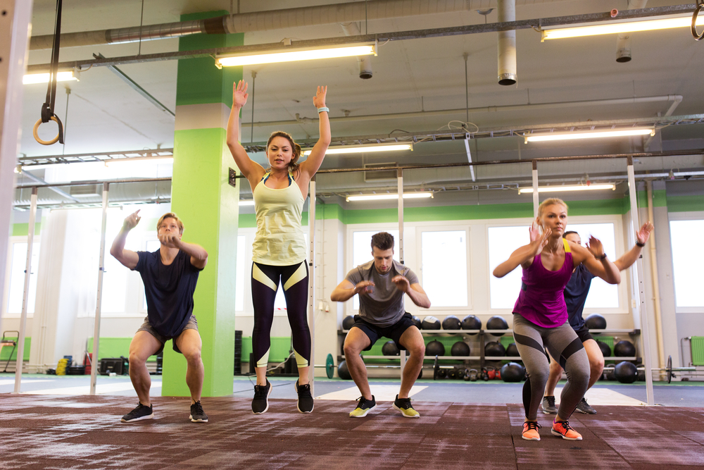 fitness group doing burpees and jumping