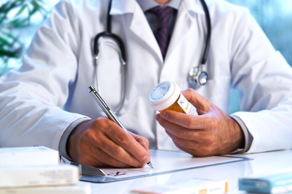 doctor writing a prescription for medication