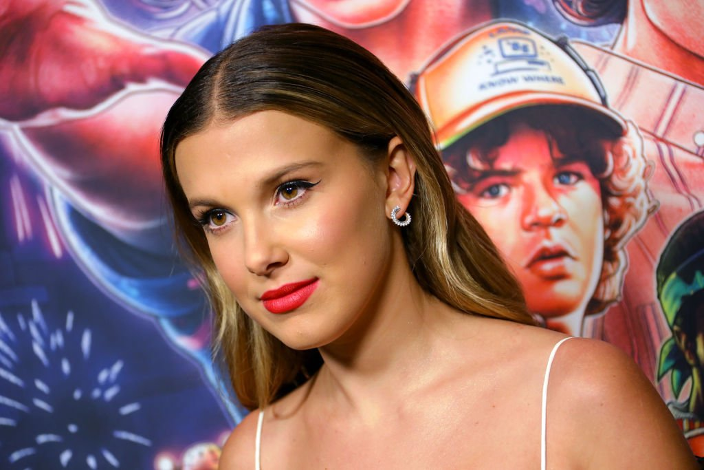 """HOLLYWOOD, CALIFORNIA - NOVEMBER 09: Millie Bobby Brown attends a photocall for Netflix's """"Stranger Things"""" Season 3 at Linwood Dunn Theater at the Pickford Center for Motion Study on November 09, 2019 in Hollywood, California."""