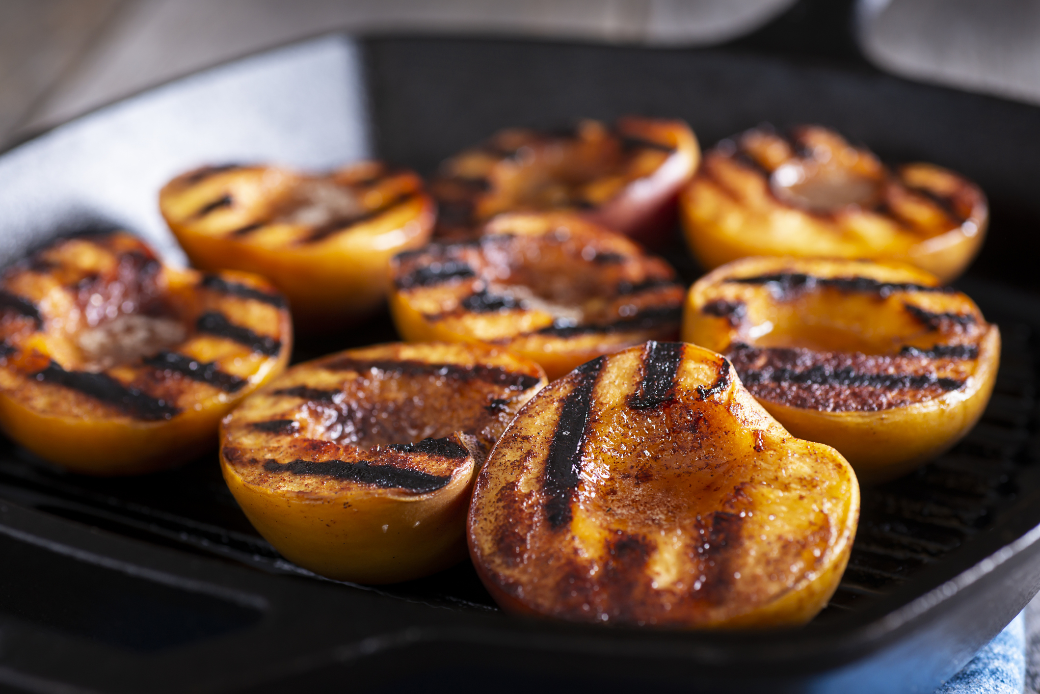 Grilled Peaches with Cinnamon and Honey in a Cast Iron Grill Pan