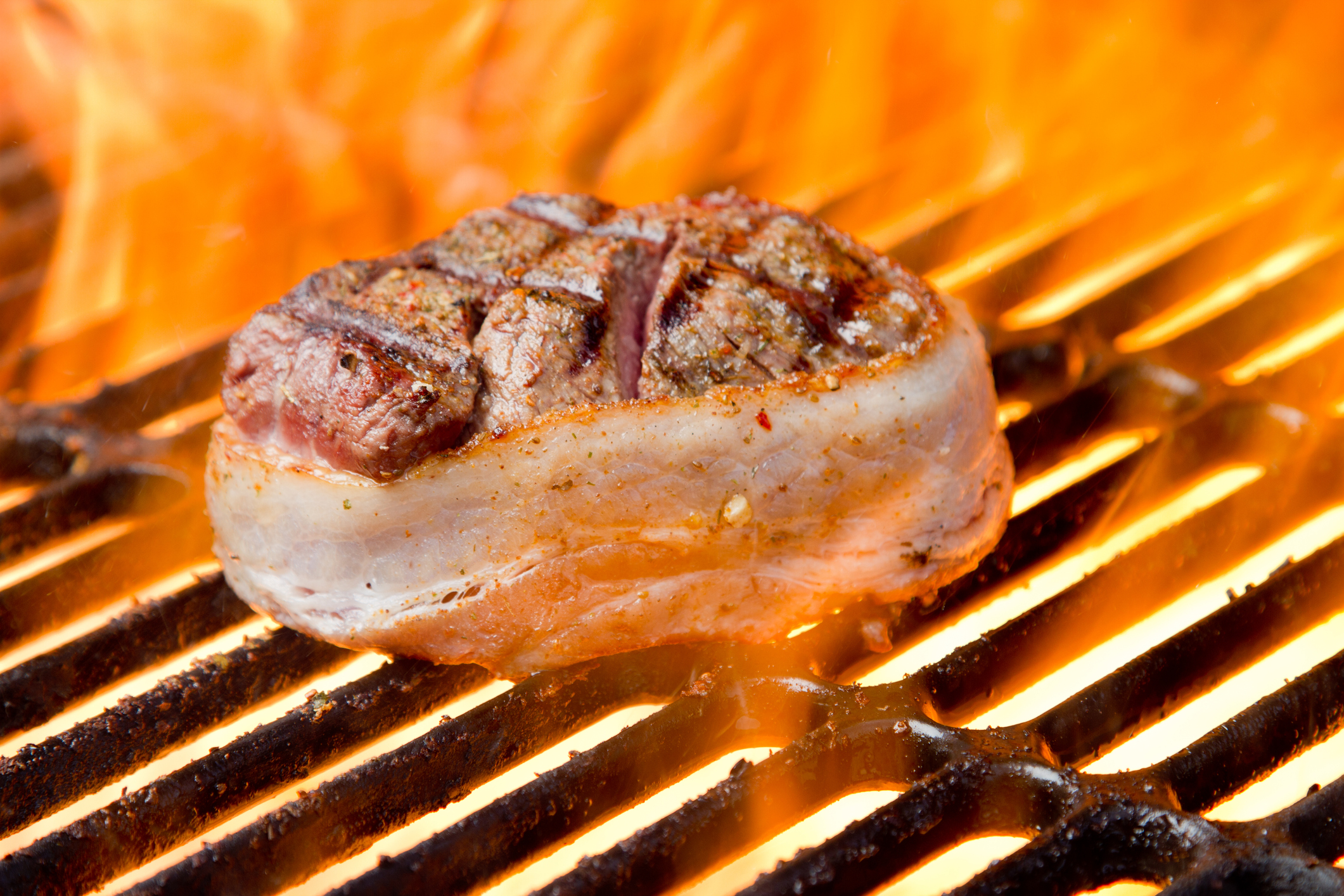Juicy filet mignon steak on the grill kissed by fire