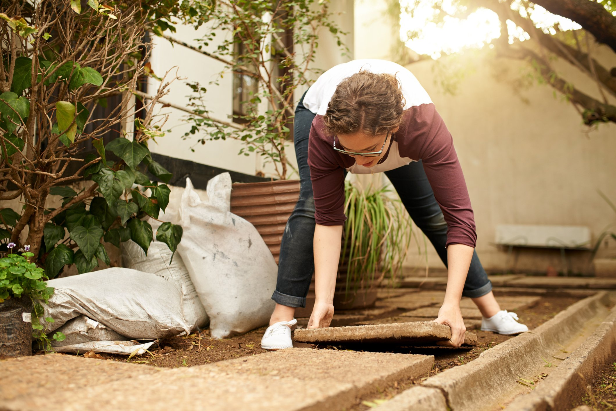 Shot of a young woman working on home improvements in her garden
