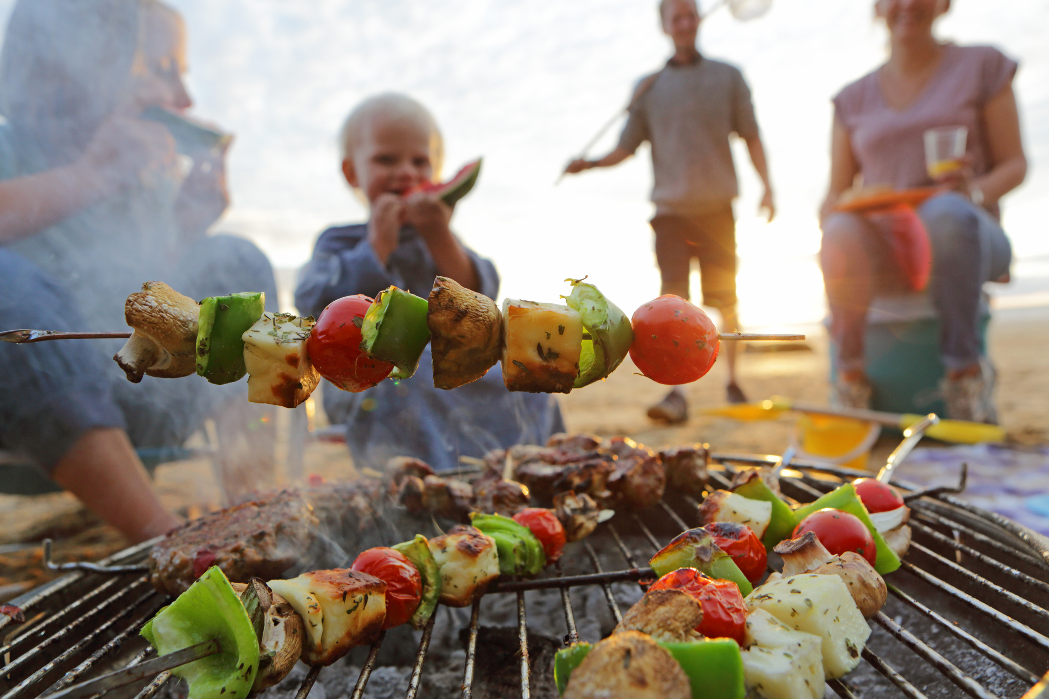Family having BBQ on beach