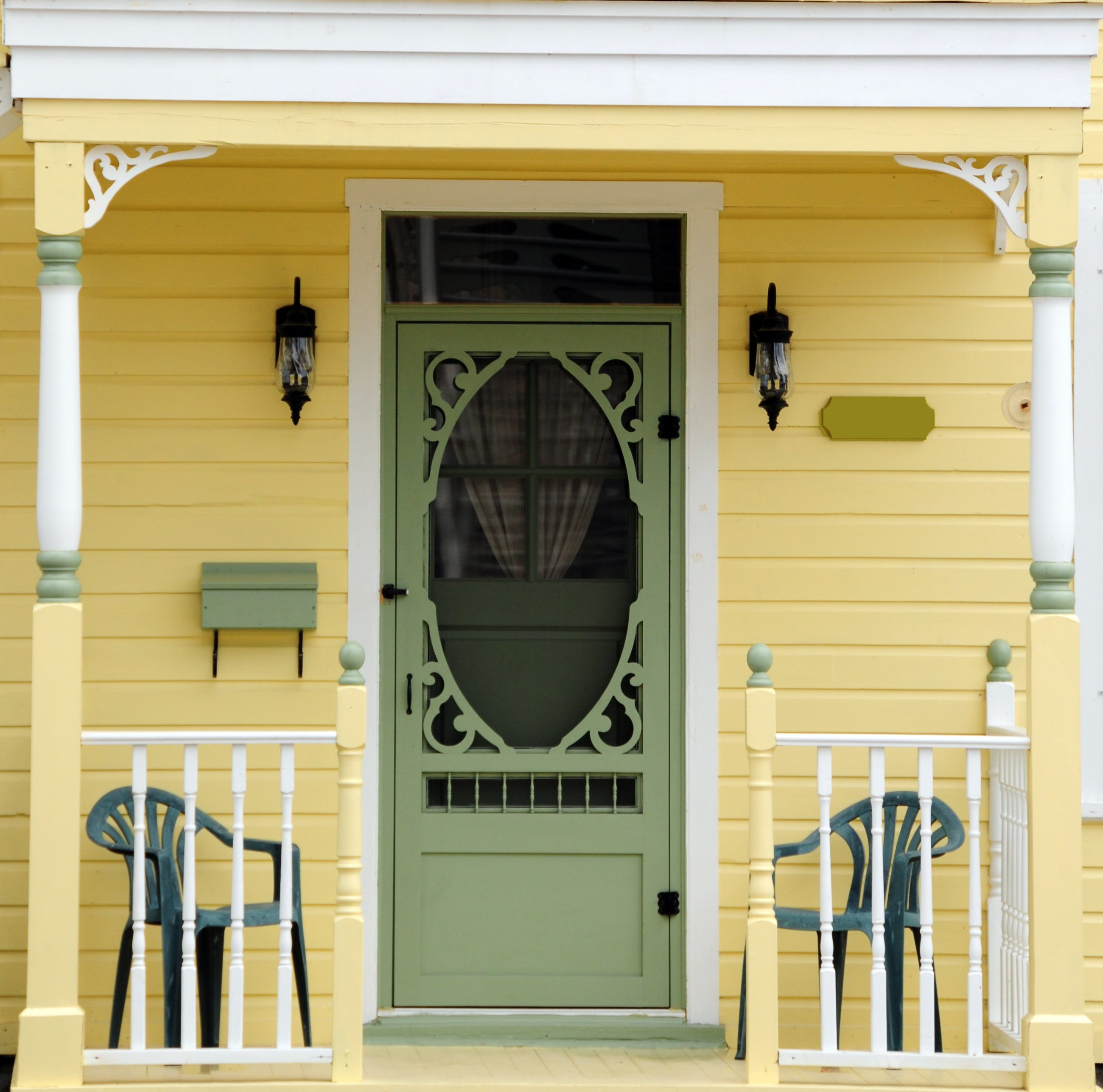 a meticulously painted victorian home...with an ornate spring door