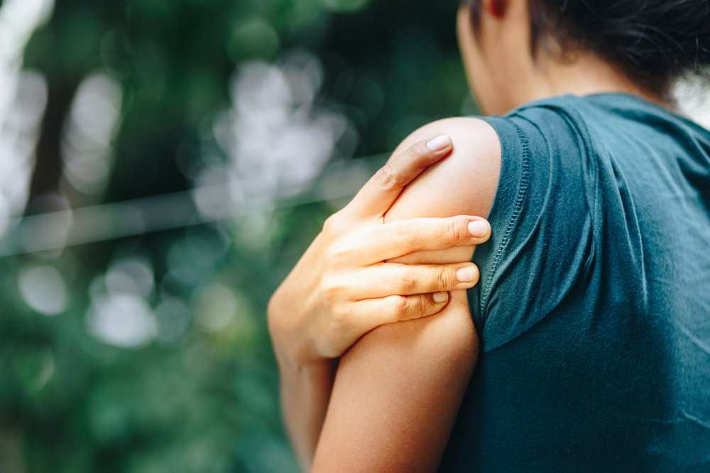 woman with a sore upper arm