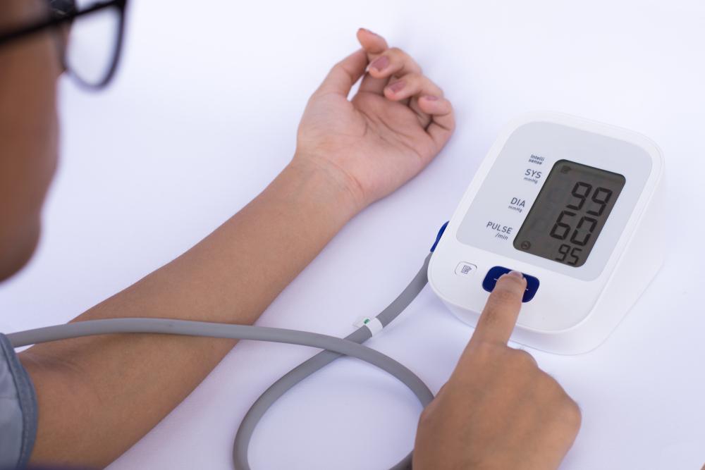 person taking blood pressure, low blood pressure