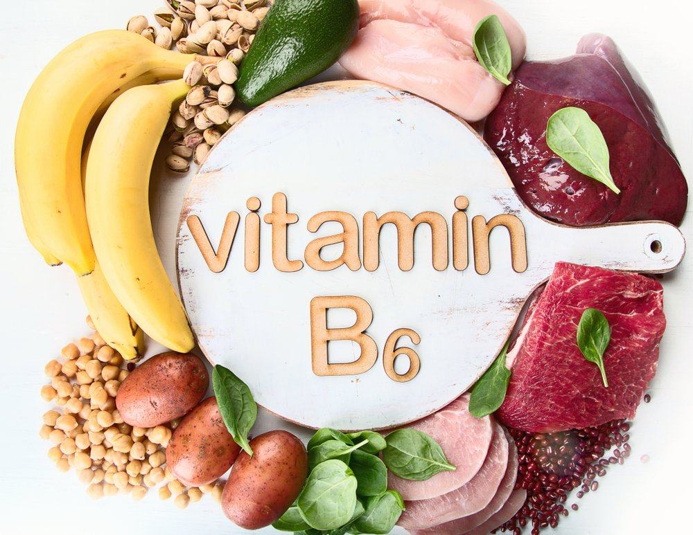 vitamin B6 on a cutting board surrounded by foods