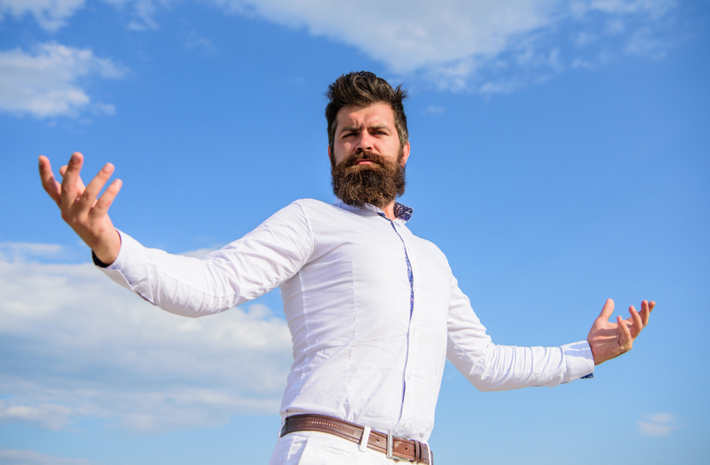 over-confident conceited man against blue sky