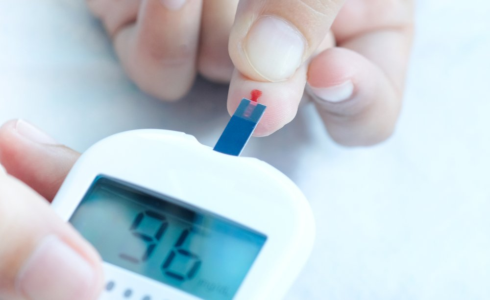cropped image of person checking their blood sugar level