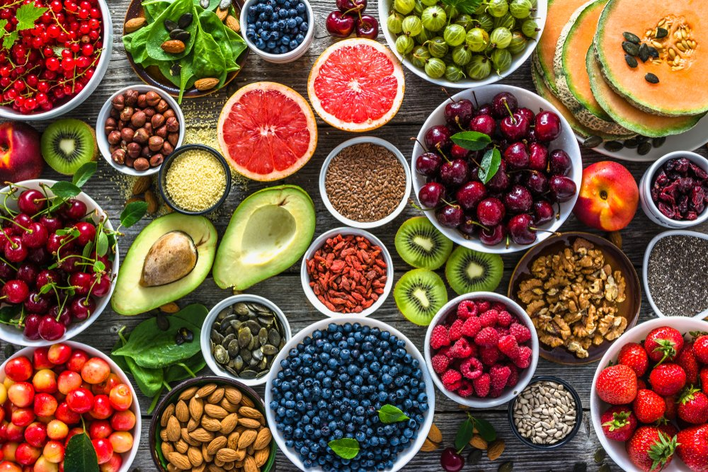 lots of fruits and nuts and other foods that are superfoods