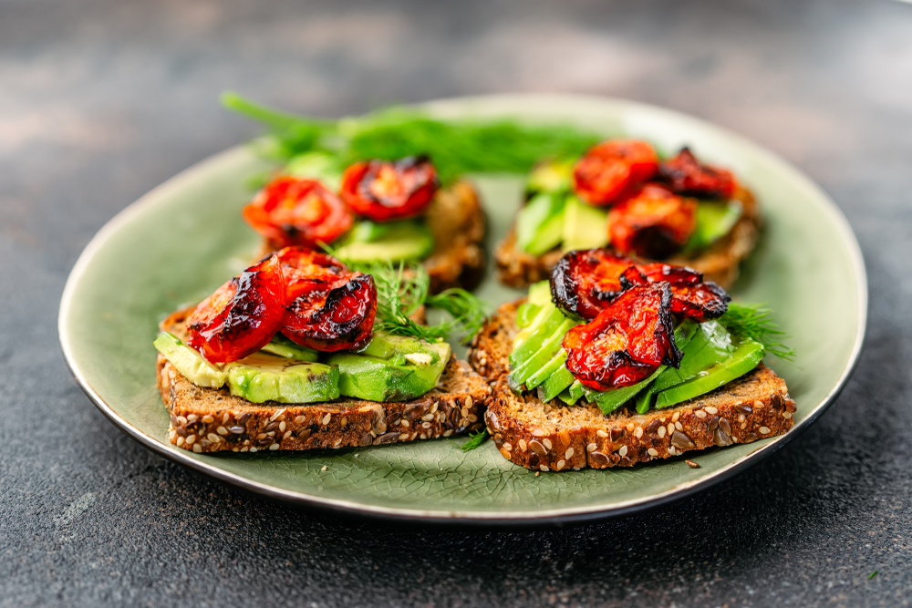 avocado and roasted tomatoes on toast