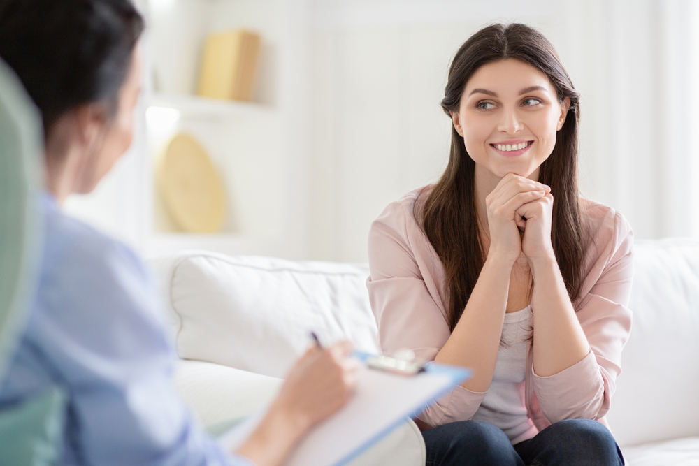 patient smiling flirtatiously at therapist