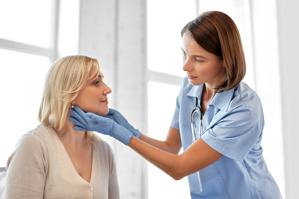 doctor feeling lymph nodes of patient