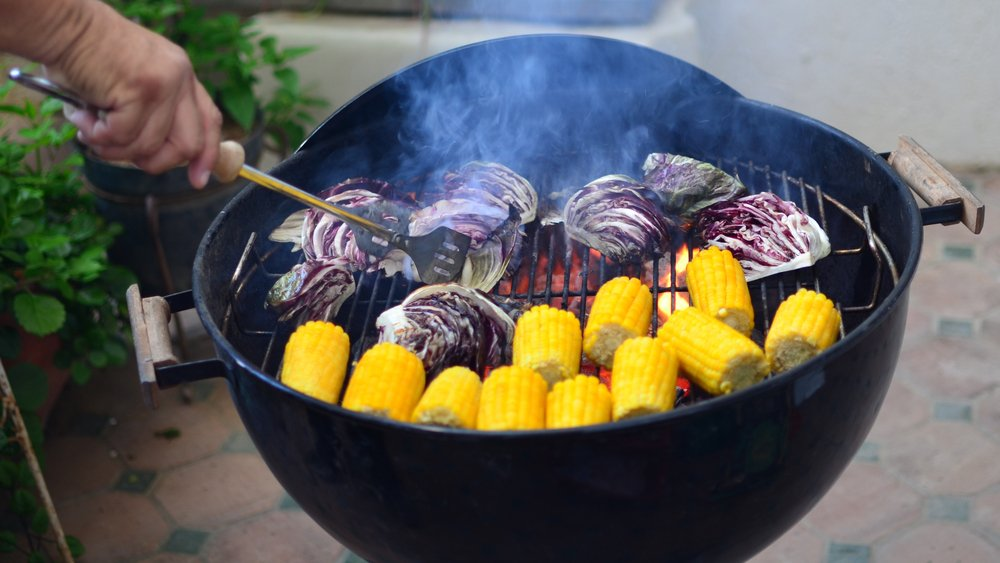 Garlic seasoned Radicchio and Sweet Corn Cobs cooking on Grill