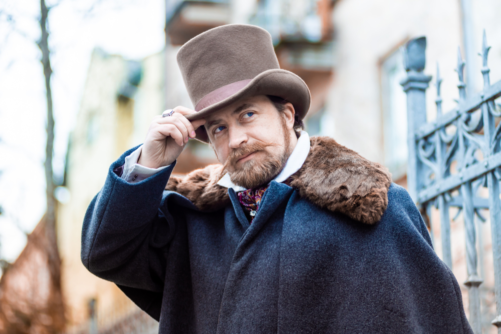 middle aged man dressed in old Victorian era clothing