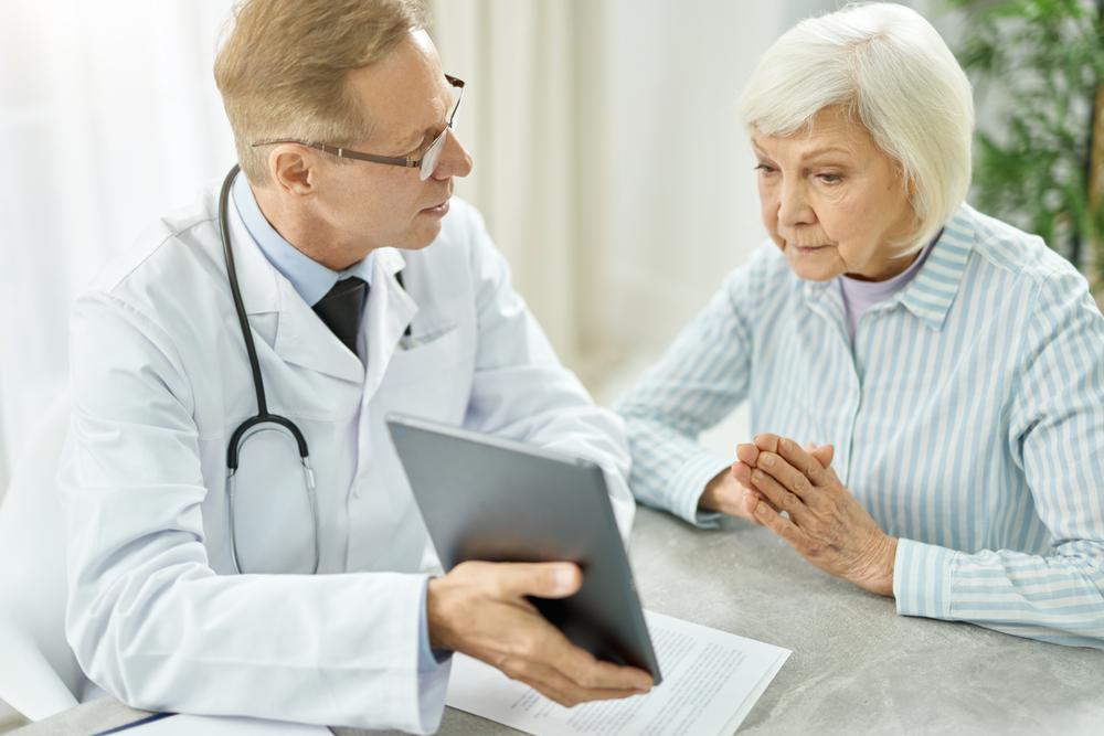doctor explaining a procedure to an elderly patient