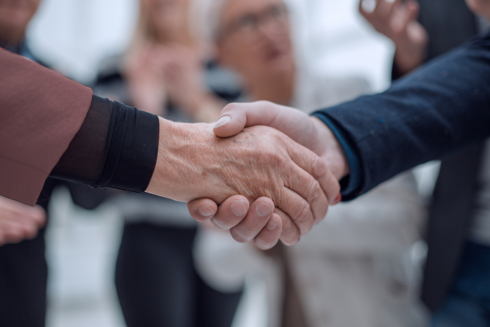 cropped image of two men shaking hands