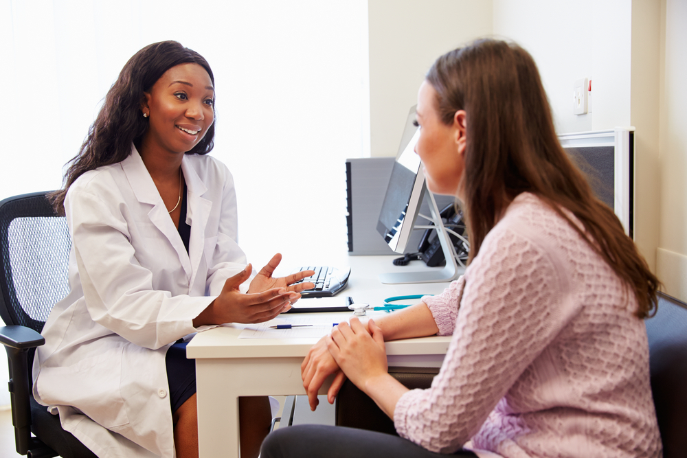 young doctor discussing treatment with patient