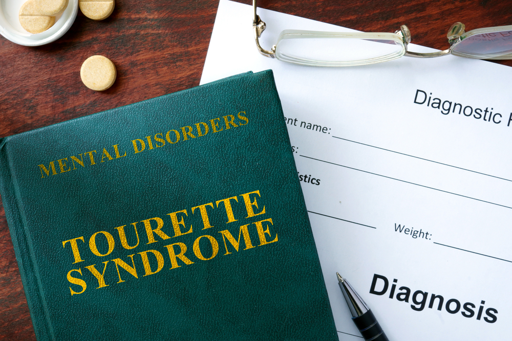 diagnosis concept with medical book for tourette syndrome
