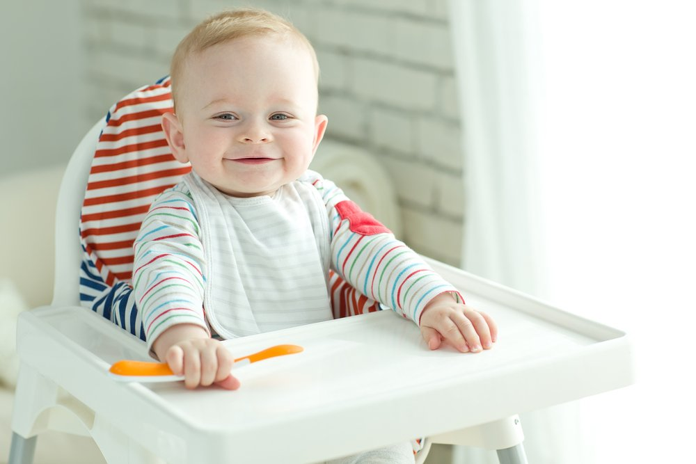 6 month old baby in high chair waiting to eat