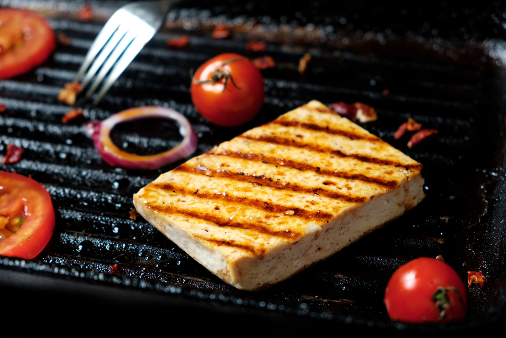 The process of cooking frying pieces of Tofu on a special grill pan