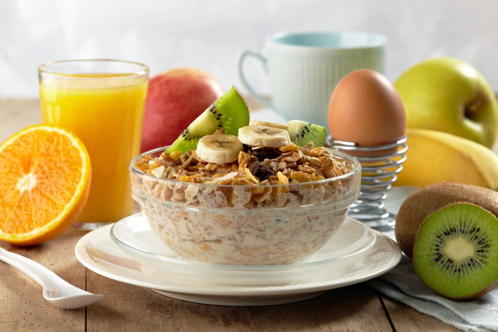 healthy breakfast with cereal, fruit, egg and orange juice